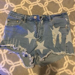 Ripped/star shorts